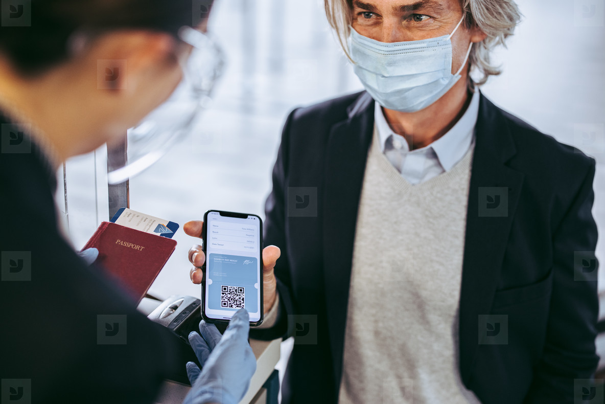 Businessman check in at airport with negative coronavirus test r