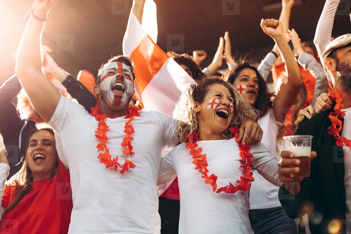 Cheering fans at football match