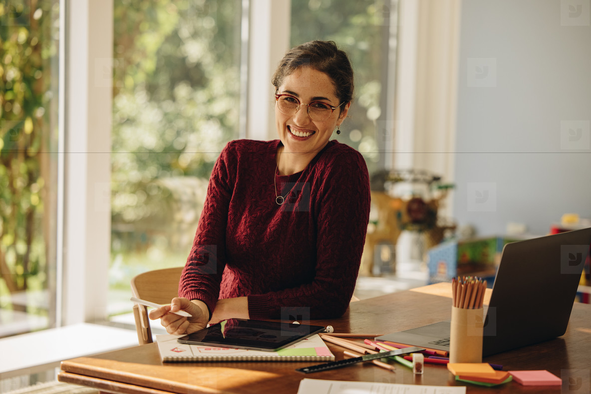 Smiling female designer sitting
