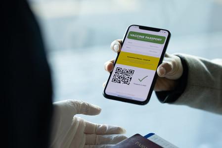 Tourist check in showing immunity e passport to ground staff