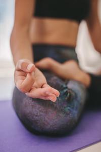 Woman hand sitting in lotus pose