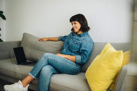 Confident woman sitting in office lobby