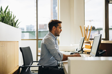 Young executive working on computer in office