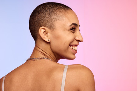 Smiling woman with shaved head