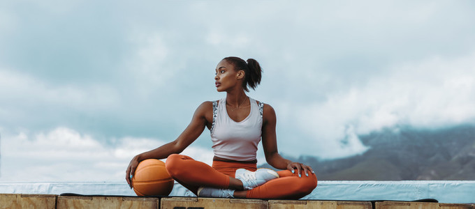 Athlete woman relaxing with basketball outdoors