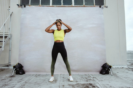 African female athlete exercising on rooftop
