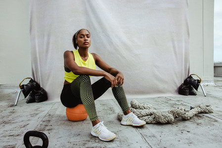 African sportswoman relaxing after workout