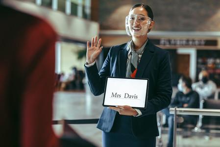 Airport stewardess welcoming Mr Davis