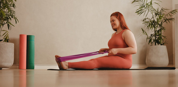 Plus size woman workout with resistance band