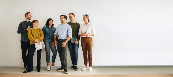 Diverse creative team looking happy