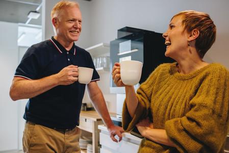 Smiling colleagues taking coffee break in office