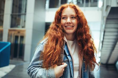 Smiling female student in college campus