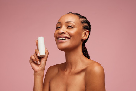 Good looking woman holding beauty product