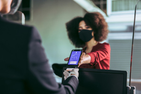 Airplane passenger checking in using electronic boarding pass on