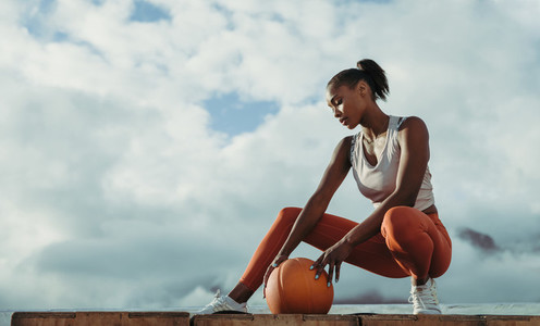 Young female with medicine ball outdoors