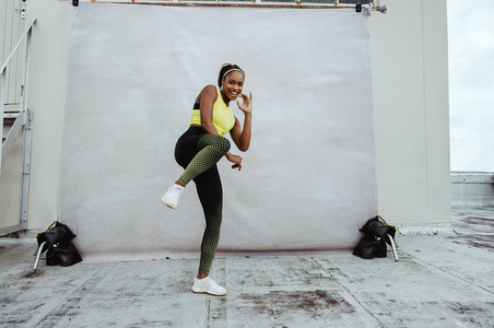 African athlete woman exercising on rooftop