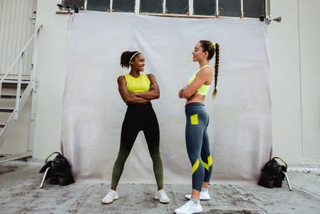 Two women in sportswear on a rooftop