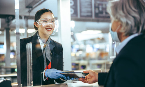 Woman working at check in desk