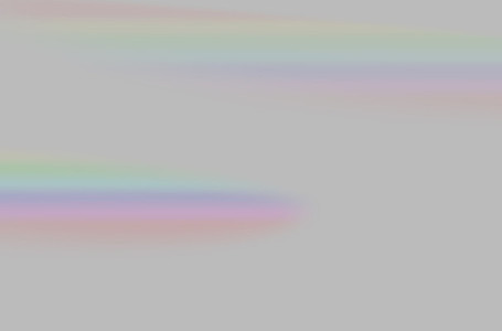 Abstract of blurred rainbow prism light overlay on grey backgrou