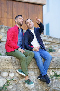 Gay couple in a romantic moment outdoors
