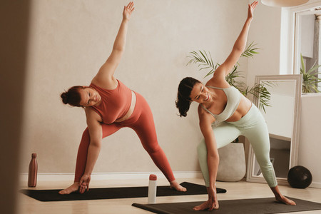 Women performing a yoga routine at gym