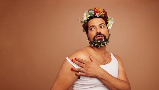 Gender queer wearing tank top and flowers
