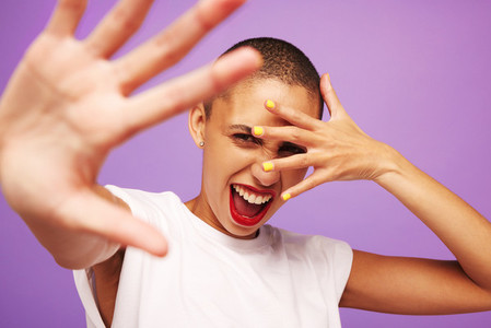 Excited female model on purple background