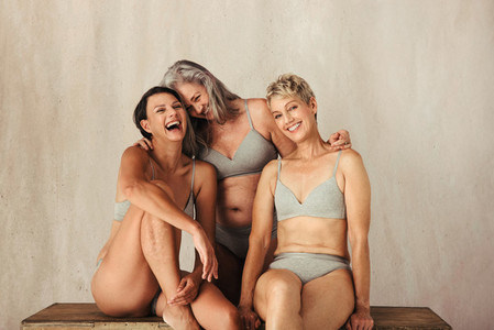 Carefree women embracing their aging bodies