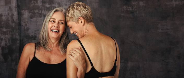 Two mature women embracing each other