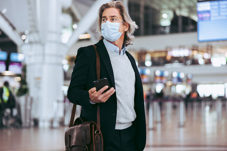 Transit passenger with face mask