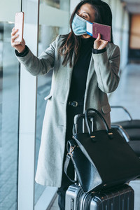 Woman on video call at airport