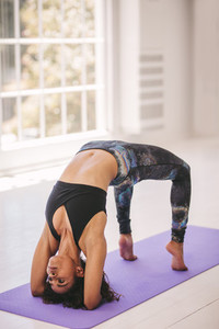Flexible woman exercising at yoga class