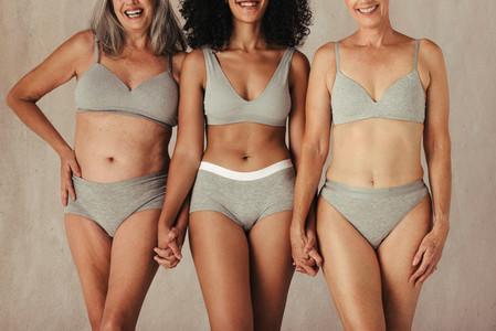 Unrecognizable natural female bodies
