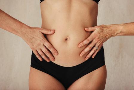 Anonymous aging female body in black underwear