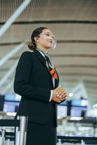 Airlines staff during pandemic at departure gate