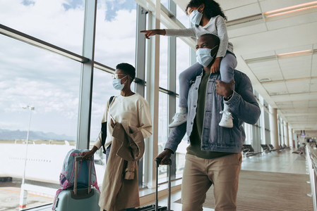 Family traveling during pandemic at airport