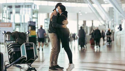 Couple reuniting at airport