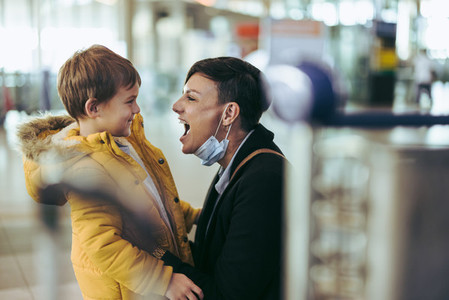 Woman excited to meet her son at airport