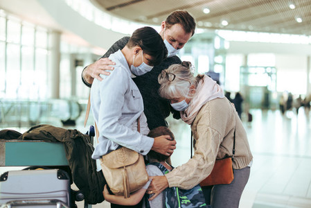 Senior woman welcoming her family at airport