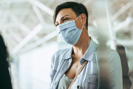 Woman tourist during pandemic at airport