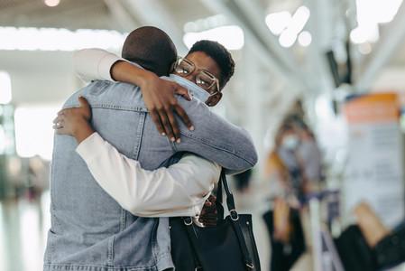 Couple giving good bye hug at airport