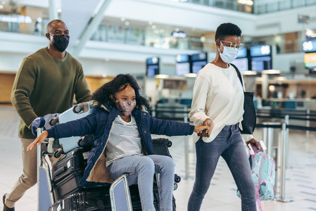 Family travelling during pandemic at airport