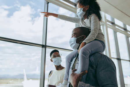 Family going for boarding their flight during pandemic