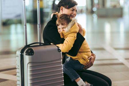 Mother getting emotional while meeting her child at airport