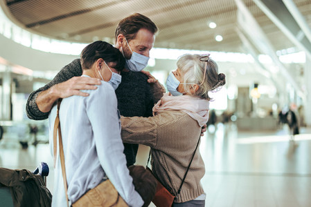 Senior man receiving her family on arrival to airport