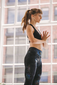Woman doing relaxation workout at fitness studio