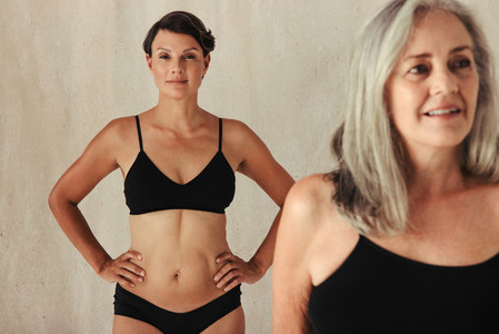 Women of different ages embracing their natural and aging bodies