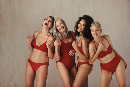 Smiling women of all ages celebrating their natural bodies