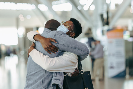 African couple reunion at airport after covid 19 lockdown