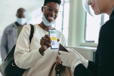 Female showing vaccine passport at airport
